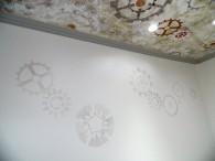 Détail décor peint engrenages